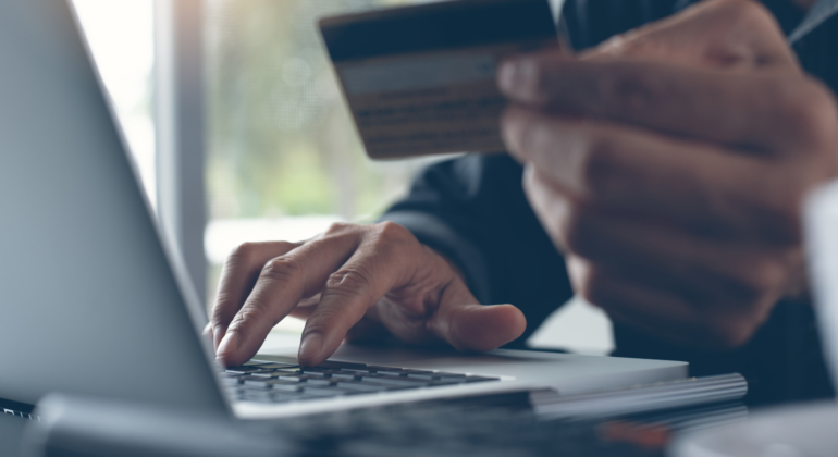 Man online shopping and internet banking on laptop computer by credit card payment, e commerce concept